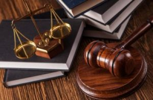 Image of gavel, scales of justice and various books